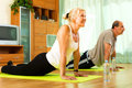 Pensioners doing exercises indoor morning Royalty Free Stock Image