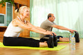 Pensioners doing exercises indoor positive morning at home Royalty Free Stock Images