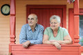 Pensioners happy couple on the porch of a country house Royalty Free Stock Photos