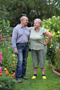 Pensioners happy elderly couple in the garden of a country house Stock Photos