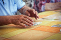 Pensioners playing cards at the kitchen table Royalty Free Stock Photo