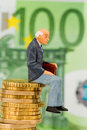 Pensioners sitting on cash pile money stack symbol photo for pension retirement pension Royalty Free Stock Image