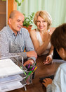 Pensioners talking with manager smiling female of at notary s office Royalty Free Stock Photos