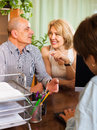 Pensioners talking with manager smiling at notary s office Stock Image