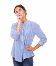 Pensive adult lady wondering and looking up portrait of on blue jeans on isolated white background copyspace Royalty Free Stock Photography