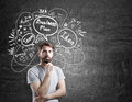 Pensive bearded man and business plan sketch Royalty Free Stock Photo