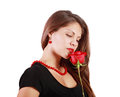 Pensive beautiful woman looks at red rose isolated on white background Royalty Free Stock Photos