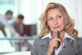 Pensive blond woman her office Royalty Free Stock Image