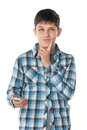 Pensive boy with a cell phone Royalty Free Stock Photo