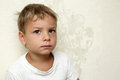 Pensive boy portrait of a on the wall background Royalty Free Stock Photography