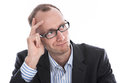 Pensive business man with glasses in suit isolated on white skeptical manager a shirt and Royalty Free Stock Photo