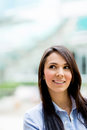 Pensive business woman looking up and smiling Royalty Free Stock Photo