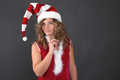 Pensive christmas woman on grey background blond Royalty Free Stock Image