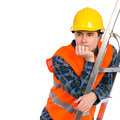 Pensive construction worker on a ladder thinking in yellow helmet and orange waistcoat looking at copy space waist up studio shot Stock Images