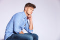 Pensive fashion young man Stock Image