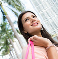 Pensive female shopper portrait of a looking up Royalty Free Stock Images