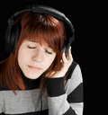 Pensive girl listening to music Royalty Free Stock Photos