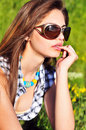 Pensive girl wearing sunglasses Stock Photography