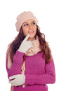 Pensive girl with wool hat and scarf isolated on a white background Royalty Free Stock Photos