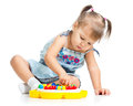 Pensive little girl playing with mosaic toy Royalty Free Stock Photo