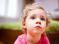 Pensive little girl portrait close up photo Royalty Free Stock Photography