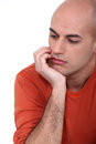 Pensive man Stock Images