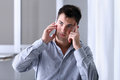Pensive man on the phone in the office business Royalty Free Stock Images