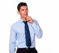 Pensive person looking to his left a portrait of a on blue shirt and tie on isolated background copyspace Stock Photos