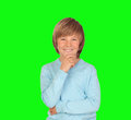 Pensive preteen boy isolated on a over green background Royalty Free Stock Photo