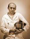 Pensive scientist with vintage monitor Royalty Free Stock Photo