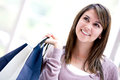 Pensive shopping woman Stock Photo