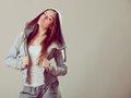 Pensive teenage girl in hooded sweatshirt. Fashion Royalty Free Stock Photo