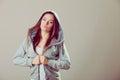 Pensive teenage girl in hooded sweatshirt. Fashion Royalty Free Stock Photo