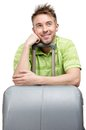 Pensive tourist leaning on travel trunk portrait of isolated white Royalty Free Stock Photo