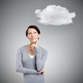 Pensive woman with cloud isolated on grey Stock Photos