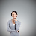 Pensive woman isolated on grey background Stock Image