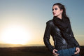Pensive woman is looking away in the dusk fashion leather jacket Royalty Free Stock Images