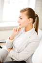Pensive woman in office bright picture of Royalty Free Stock Images