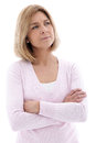 Pensive woman standing with folded arms middle aged blond staring up into the air a frown isolated on white Royalty Free Stock Photos
