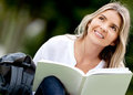 Pensive woman studying outdoors Royalty Free Stock Images