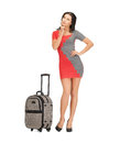 Pensive woman with suitcase Royalty Free Stock Photo