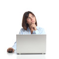 Pensive woman thinking while is using a laptop and looking sideways isolated on white background Stock Images
