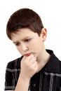 Pensive young boy isolated on white background with hand head Royalty Free Stock Images