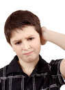 Pensive young boy isolated on white background with hand head Royalty Free Stock Image