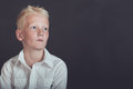 Pensive young boy looking upward over black Royalty Free Stock Photo