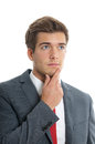 Pensive young businessman man lost in thought Royalty Free Stock Photos
