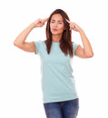 Pensive young lady with eyes closed standing portrait of on blue t shirt her on isolated white background Stock Photos
