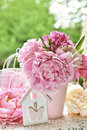 Peony bunch in vase on the table in the garden with color effect Royalty Free Stock Photo
