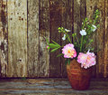 Peony flowers in vase on wood. Stock Photography