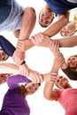 People with arms linked showing unity Stock Photo
